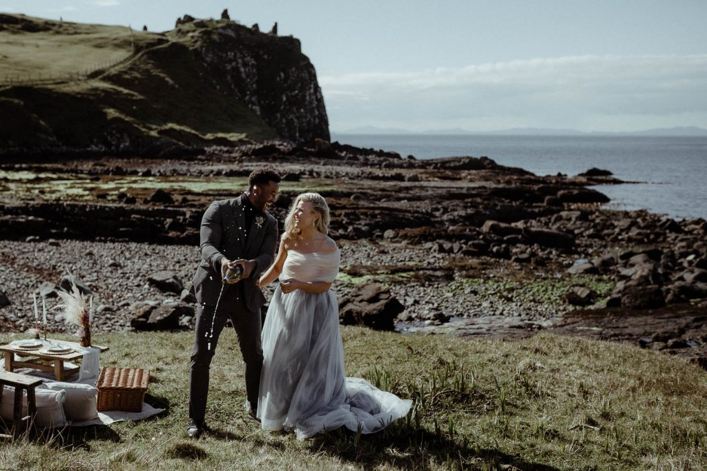 duntulm-castle-elopement-isle-of-skye-married-couple-spraying-champagne