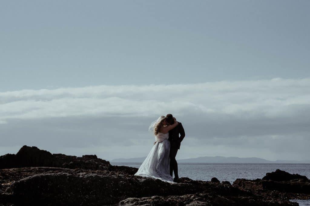 isle-of-skye-elopement-couple-portrait-on-the-rocks-at-duntulm-castle
