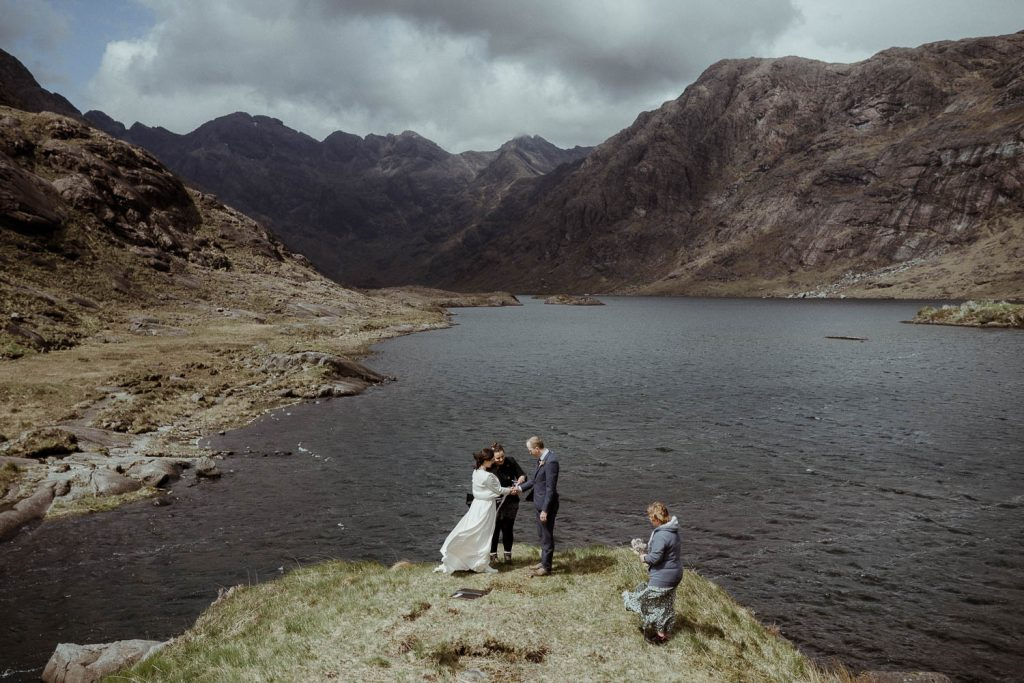 Elopement Ceremony Ideas couple at their elopement ceremony at Loch Coruisk, Isle of Skye