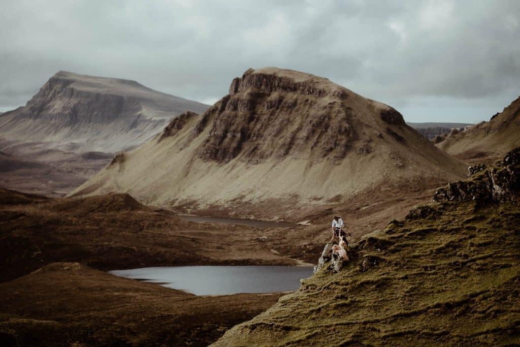 Adventurous Elopement with couple walking along a mountain ridge on the Isle of Skye